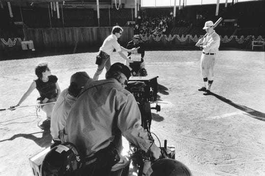 Director of Photography Bob Richardson (behind camera) prepared to shoot a scene at home plate during the filming of Eight Men Out. Bush Stadium was transformed into the Cincinnati Red's home park for the  film, which was released in 1988.