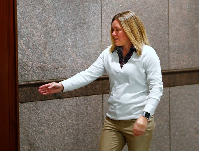 Julia Whistler, mother of Ella Whistler, heads back into the courtroom for the hearing of the Noblesville West Middle School shooting suspect, at the Hamilton County Government and Judicial Center, Wednesday, Nov. 14, 2018.