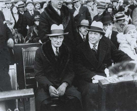 Knute Rockne, right, Notre Dame coach, was the guest of New York City Mayor James J. Walker, left, at the start of the Notre Dame-Army football game at Yankee Stadium on Dec. 13, 1930. (AP Photo)