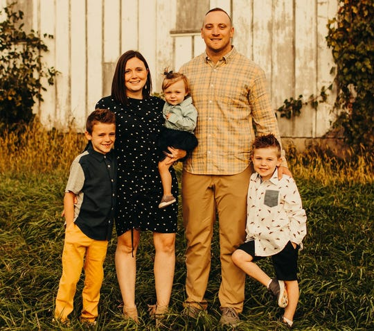 Pat Angerer with wife, Mary, and children Cael, 7, Emmett, 4, and Avery, 1.