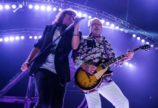 Kelly Hansen, left, and Mick Jones of Foreigner perform