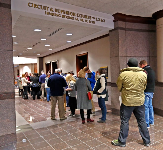 People wait in line to enter the Hamilton Superior Court No. 1, for the hearing of the Noblesville West Middle School shooting suspect, at the Hamilton County Government and Judicial Center, Wednesday, Nov. 14, 2018.