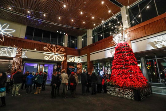 Guests explore the Wintermarket at the Indianapolis Museum of Art at Newfield's Winter Lights, on Tuesday, Nov. 13, 2018.