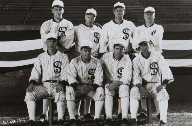 "Back row left to right: John Cusack, Michael Rooker, James Read, Perry Lang. Bottom row left to right: Don Harvey, Charlie Sheen, D.B. Sweeney, and David Strathairn in the film ""Eight Men Out."""