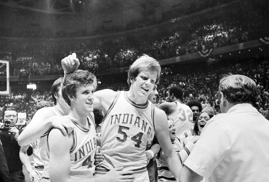 Kent Benson (54) is congratulated by teammate Jim Crews (left) after being named MVP of the 1976 NCAA Final Four at Philadelphia. IU defeated Michigan, 86-68, in the title game.