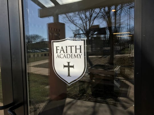 A design for Parkview Church's Faith Academy is shown on the church's front door on Nov. 13, 2018.