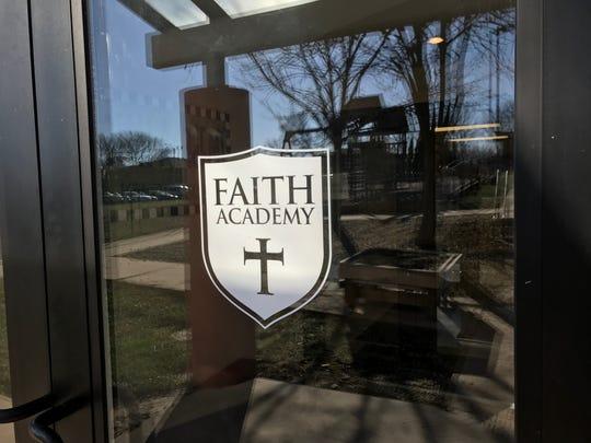 A design for Parkview Church's Faith Academy is shown on the church's front door on Nov. 13, 2018.