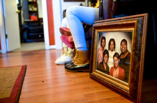 A framed family portrait leans against the couch, with Tory Howard featured in the center of the family photo, at the home of Martha Epperson in Jackson, Tenn., on Wednesday, Nov. 7, 2018.