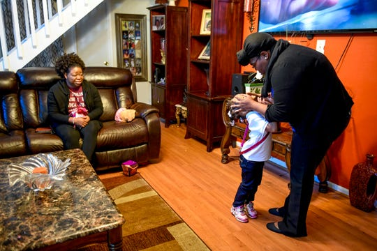 Jaliyah Allen, 4, and Terrica Howard, right, play around while the family watches television at the home of Martha Epperson in Jackson, Tenn., on Wednesday, Nov. 7, 2018.