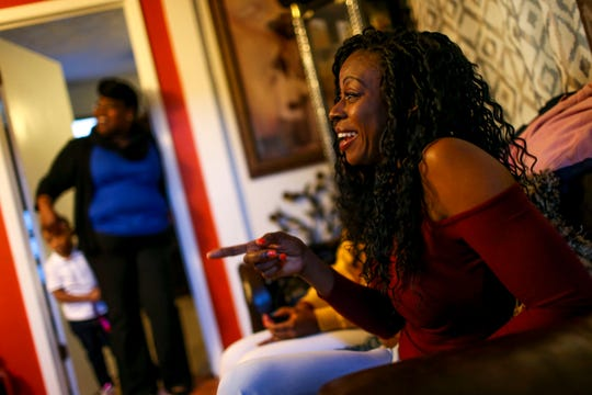 Sherrika Howard points and remembers her sister Tory Howard's movie and television watching habits fondly at the home of Martha Epperson in Jackson, Tenn., on Wednesday, Nov. 7, 2018.