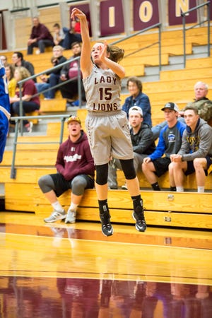 Dresden alumnus Carrie Hatchel follows through with a 3-pointer from the wing for Freed-Hardeman.
