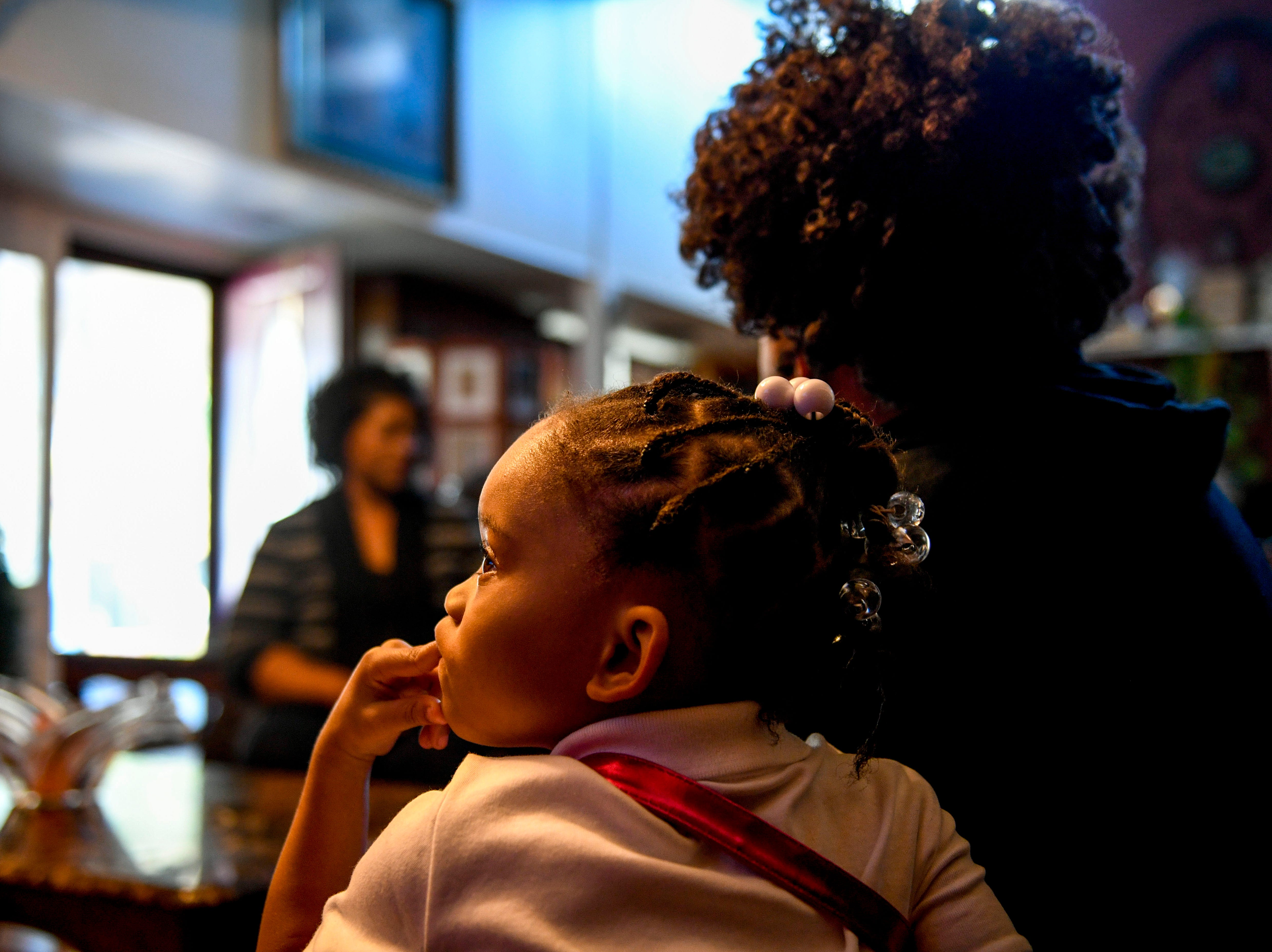 Jaliyah Allen, 4, Tory Howard's youngest daughter, watches television on the couch with Margaret Theus, one of Tory Howard's sisters, at the home of Martha Epperson in Jackson, Tenn., on Wednesday, Nov. 7, 2018.