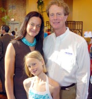 FILE: 3/26/07: Jonathan Harlan, left, with his wife Fiona and daughter Georgina at the Business After Hours at the Aeneas Building Thursday in downtown Jackson.