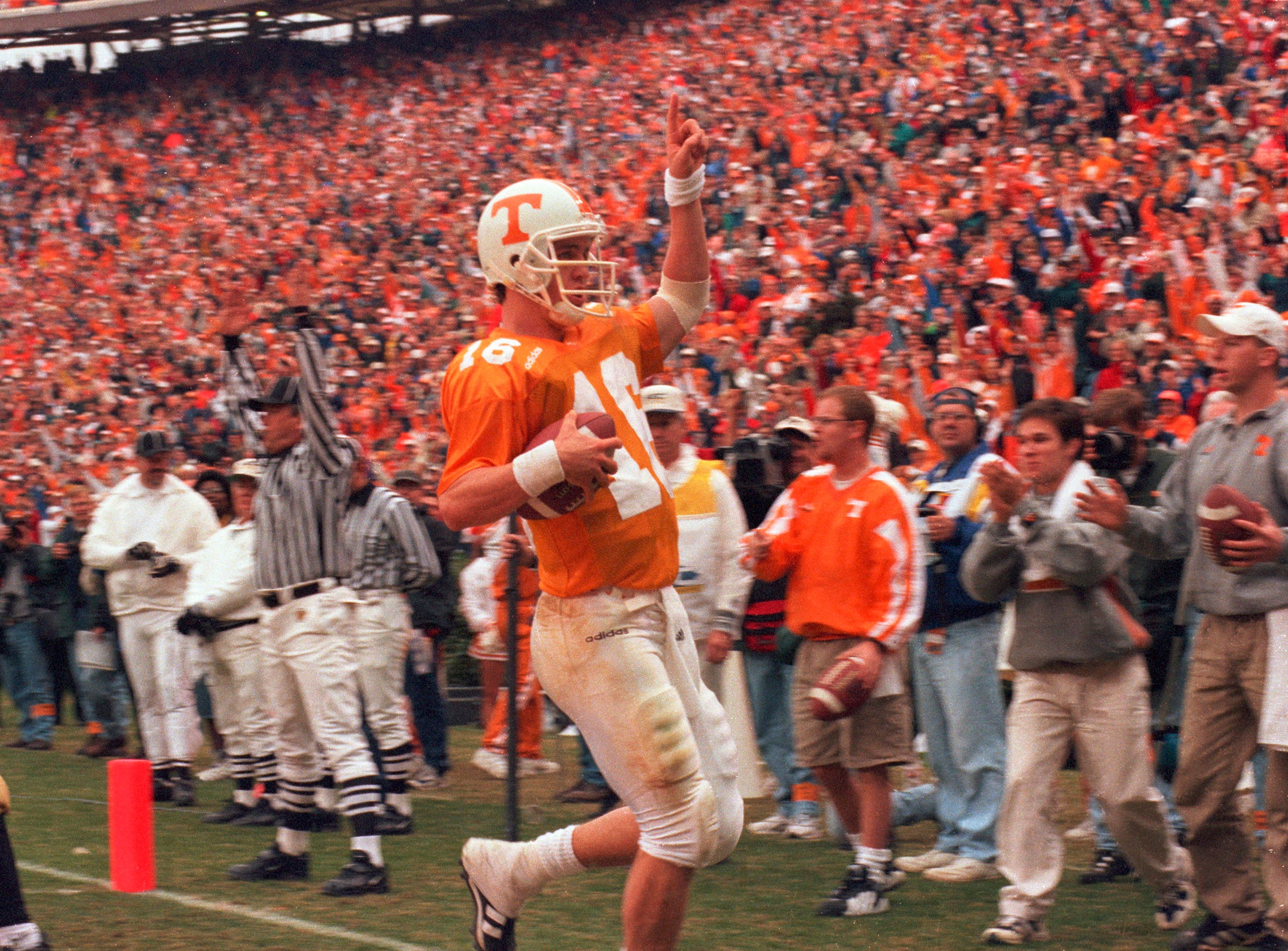 In a Nov. 29, 1997, photograph, Tennessee quarterback Peyton Manning scores the winning touchdown in a 17-10 victory over Vanderbilt during his final game at Neyland Stadium.