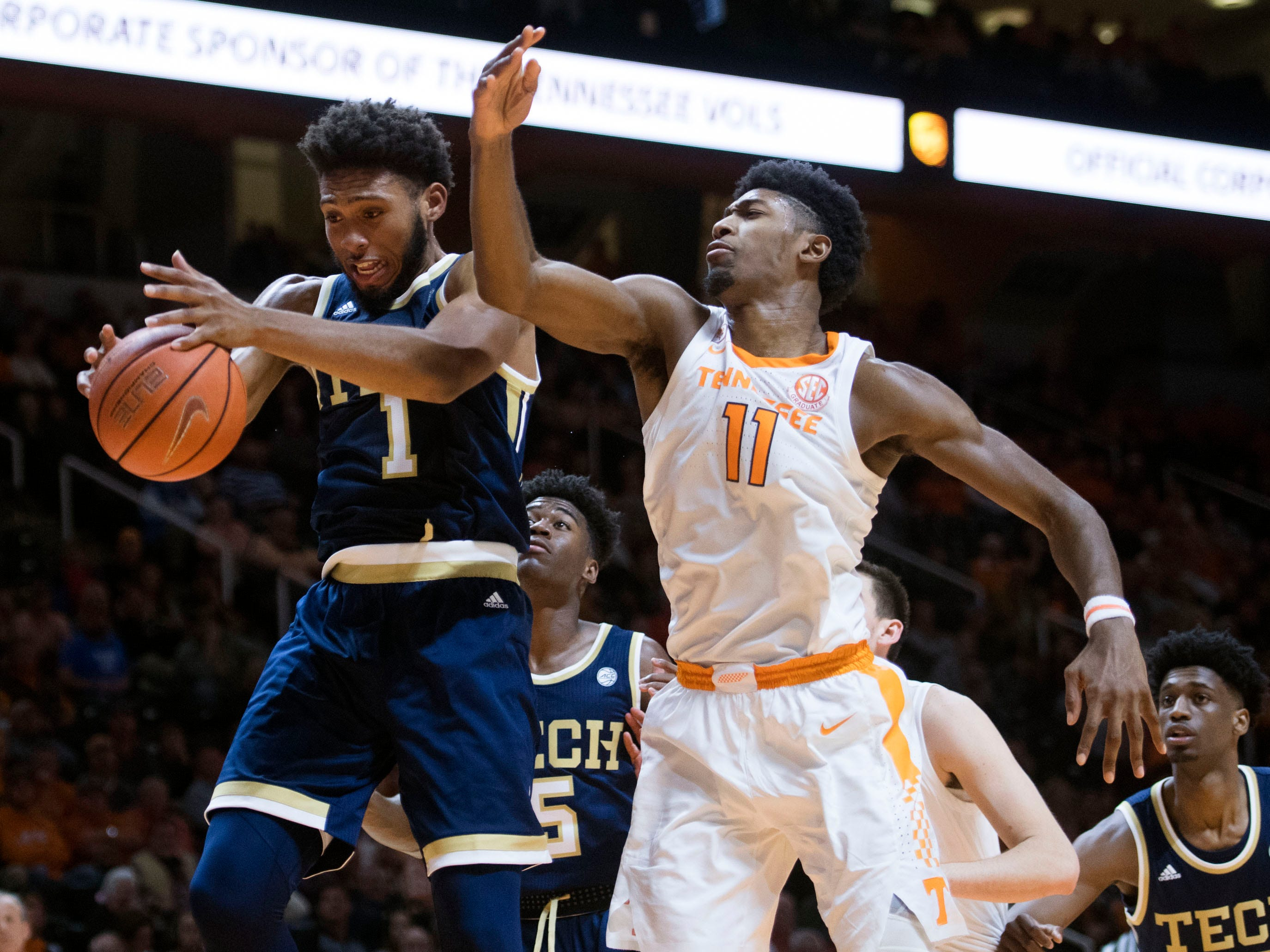 Tennessee's Kyle Alexander (11) tries to get the rebound with Georgia Tech's James Banks III (1) on Wednesday, November 14, 2018.
