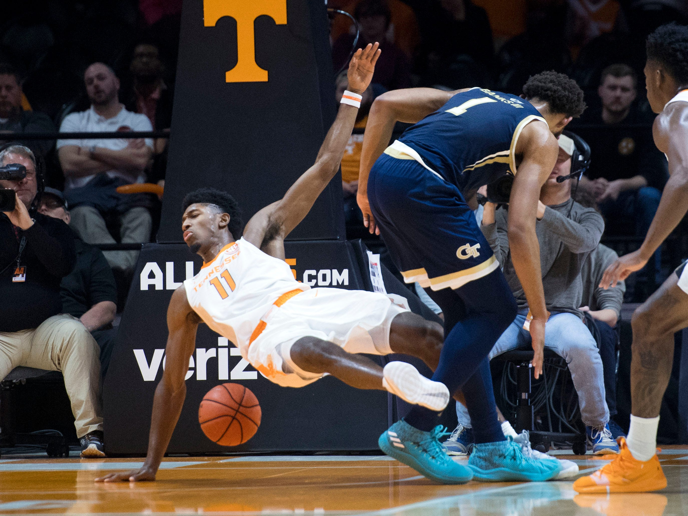 Tennessee's Kyle Alexander (11) draws a foul against Georgia Tech's James Banks III (1) on Wednesday, November 14, 2018.