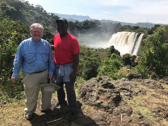 Victor Ashe and Sam Anderson at the source of the Blue Nile in Ethiopia.