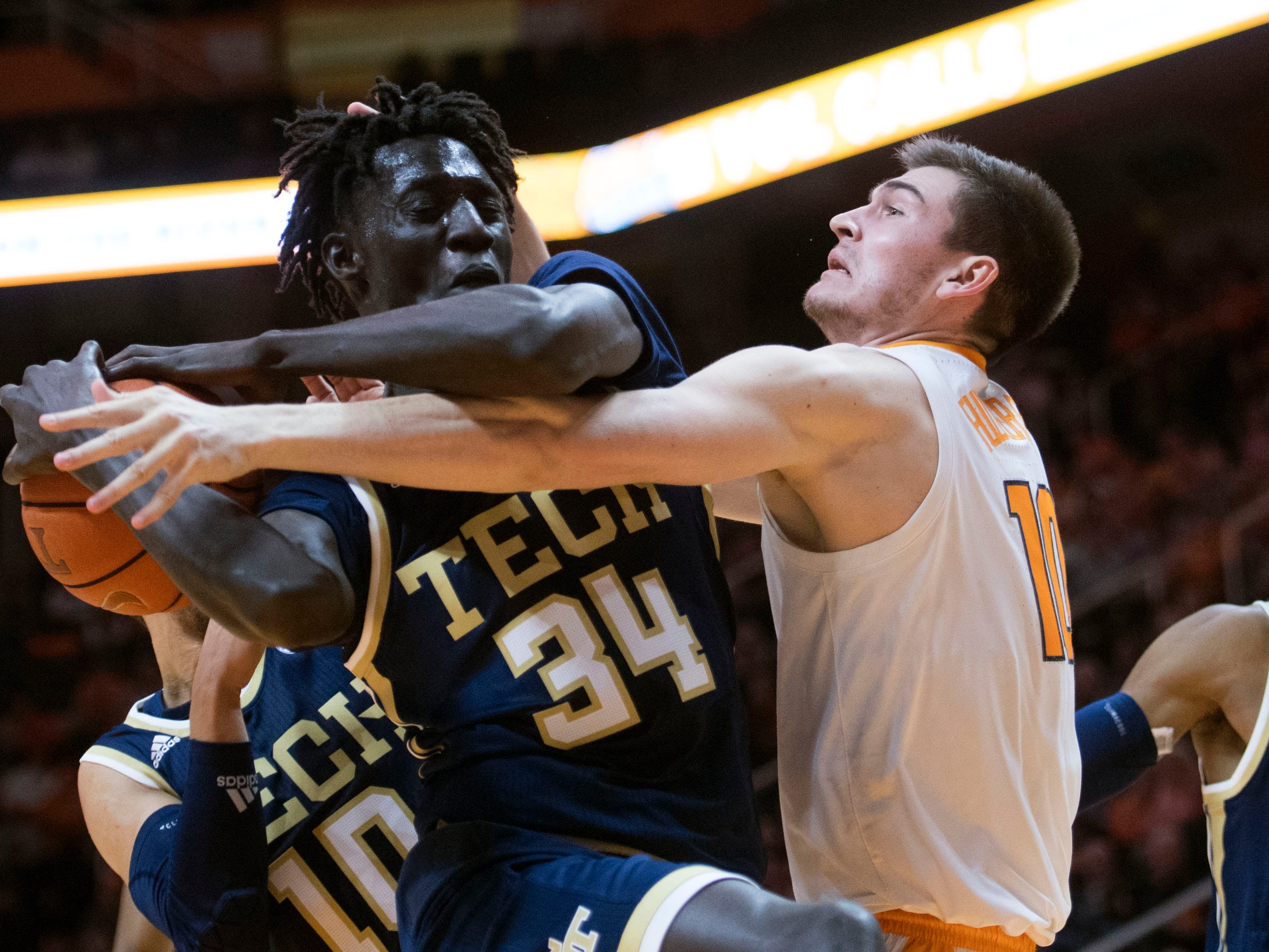 Tennessee's John Fulkerson (10) and Georgia Tech's Abdoulaye Gueye (34) go after a rebound at Thompson-Boling Arena on Tuesday, November 13, 2018.