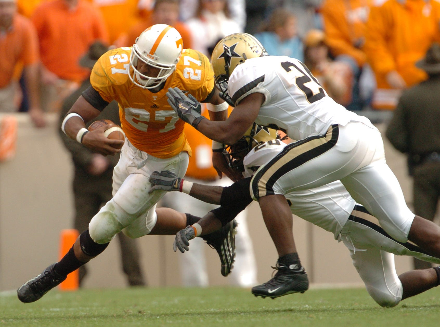 UT's Arian Foster (27) gets chased down by Vanderbilt defenders at Neyland Stadium Saturday afternoon on 11/19/2005.