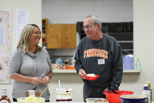 Central Baptist church member Paige Corcoran and Church of the Good Shepherd member Roy Arthur chat following dinner on Nov. 12.