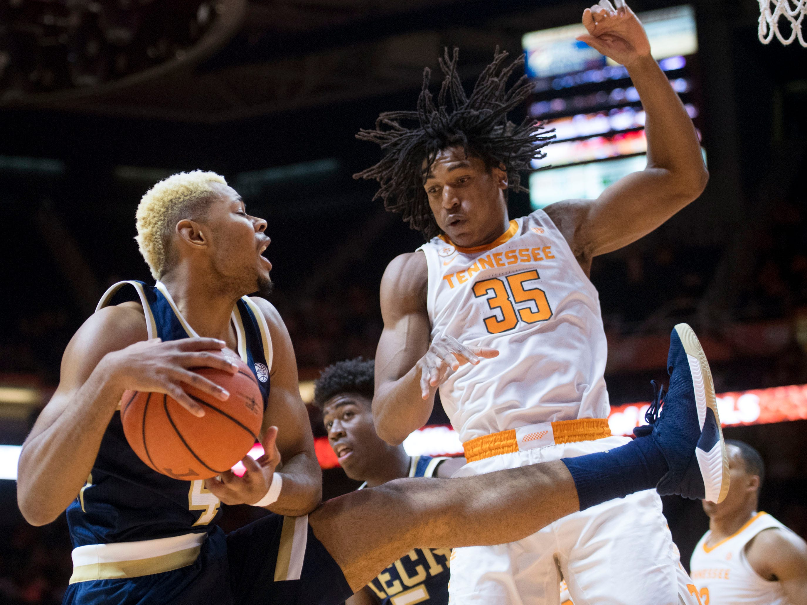 Georgia Tech's Brandon Alston (4) gets the rebound over Tennessee's Yves Pons (35) on Tuesday, November 13, 2018.