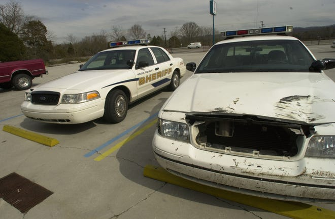 Two Knox County Sheriff's Office cruisers that were wrecked during a chase await repair in 2003.