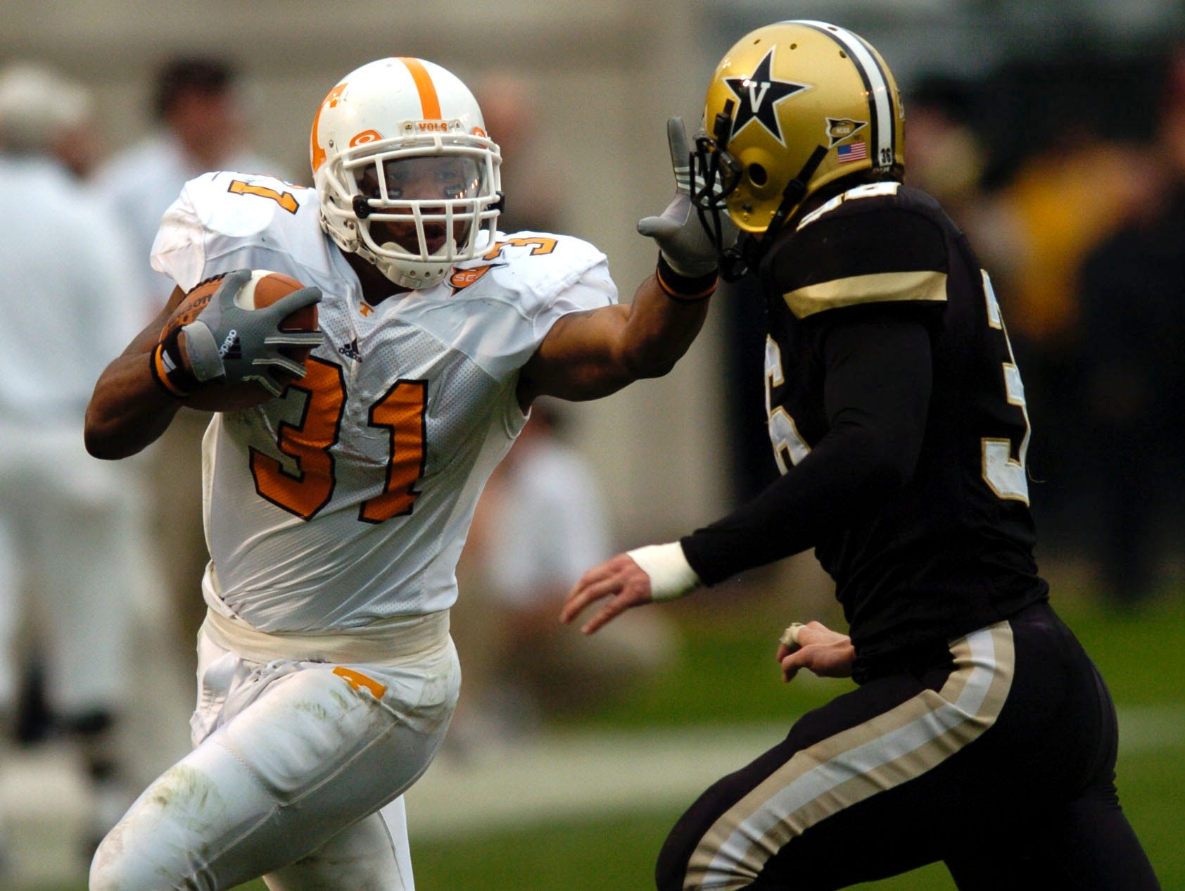 UT's Gerald Riggs, Jr. pushes off Vanderbilt's Andrew Pace on 11/20/04.