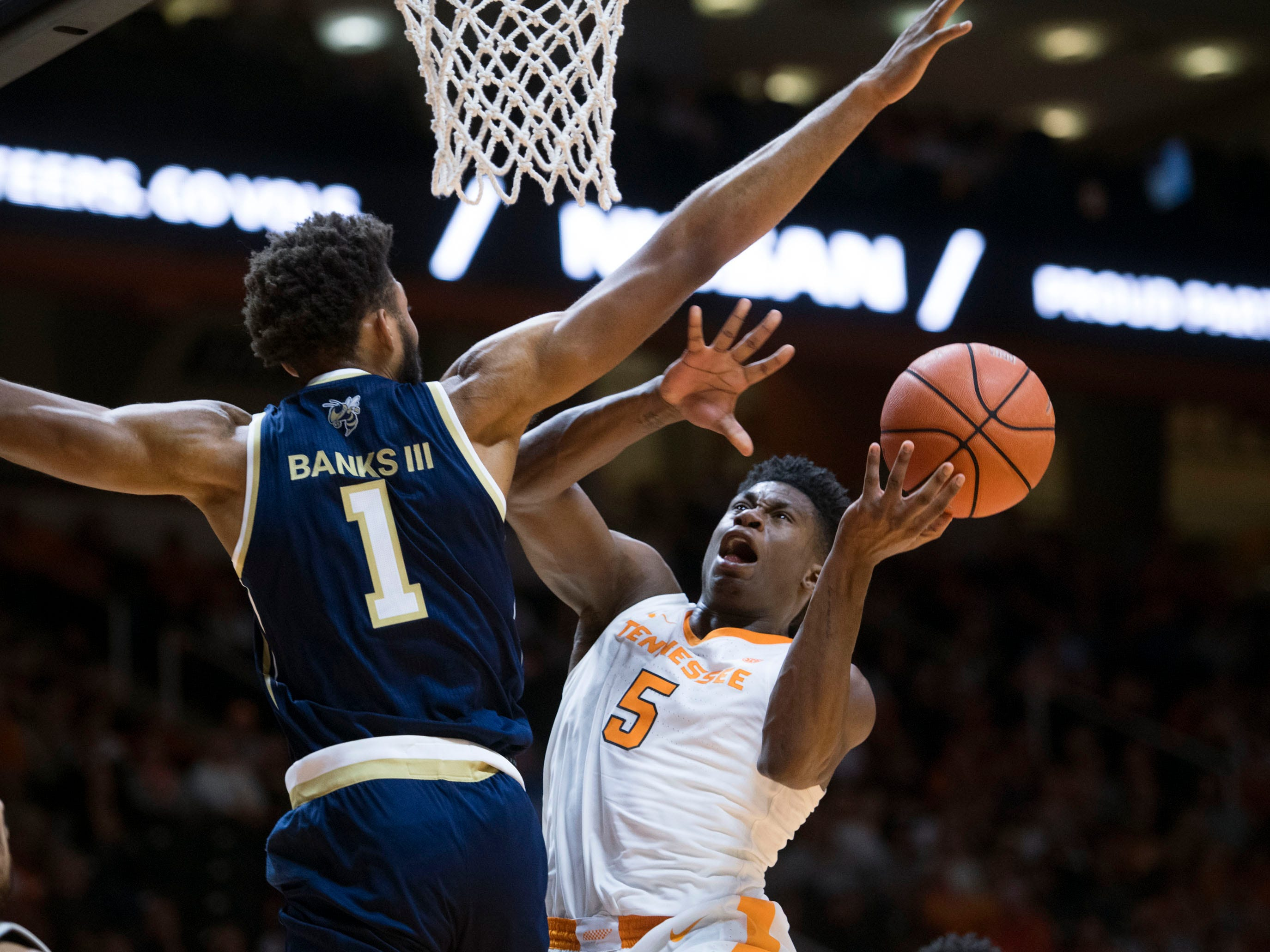 Tennessee's Admiral Schofield (5) attempts to score while defended by Georgia Tech's James Banks III (1) at Thompson-Boling Arena on Tuesday, November 13, 2018.
