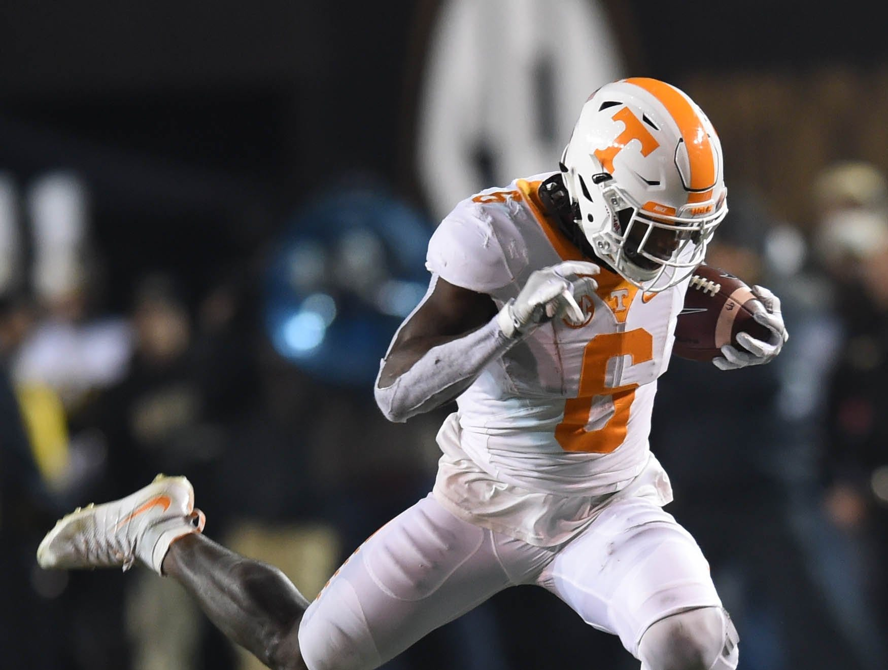 Tennessee running back Alvin Kamara (6) leaps over Vanderbilt safety Ryan White (14) during the first half at Vanderbilt Stadium on Saturday, Nov. 26, 2016. Vanderbilt won the game 45-34.