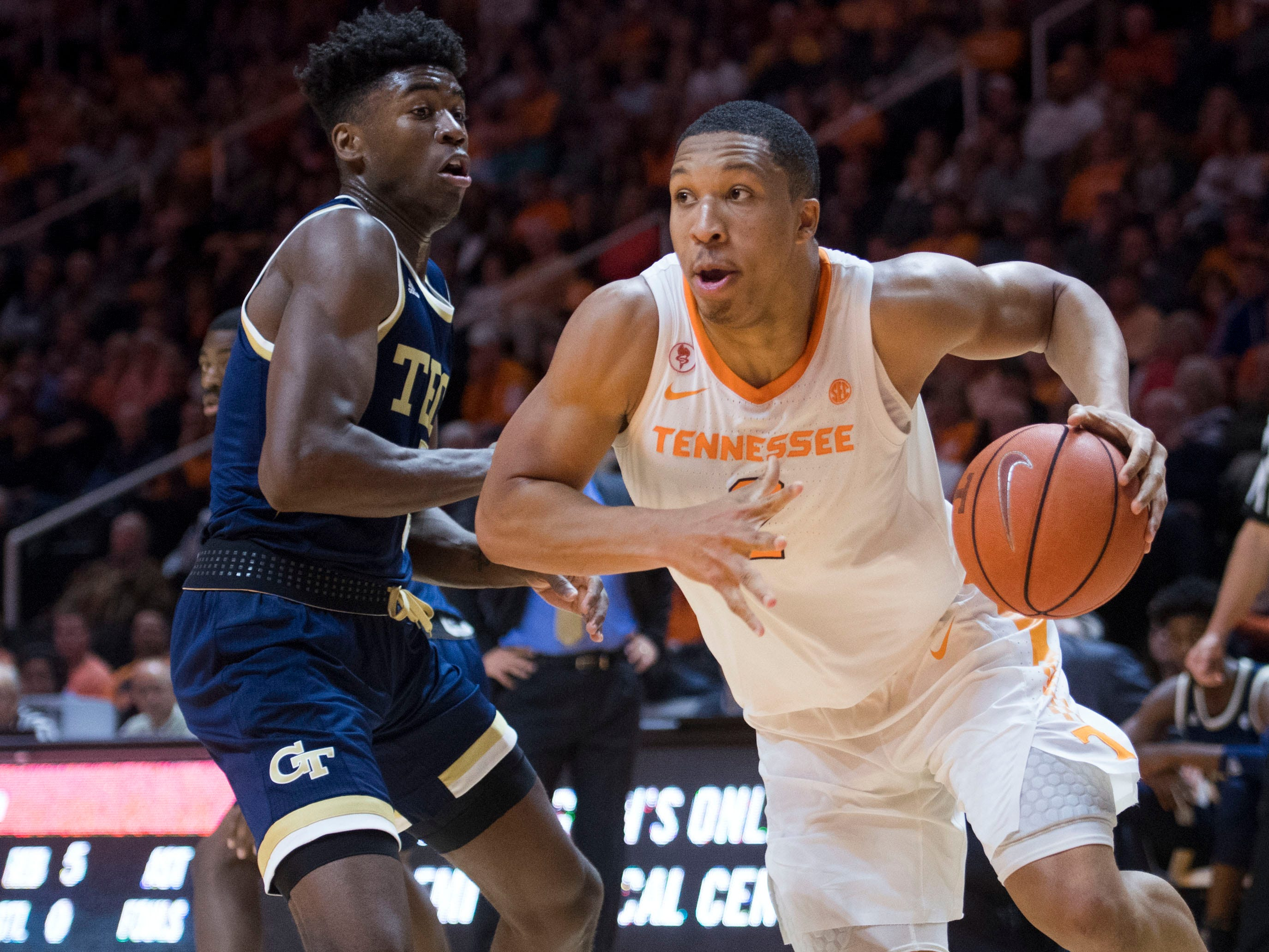 Tennessee's Grant Williams (2) drives towards the basket while defended by Georgia Tech's Moses Wright (5) at Thompson-Boling Arena on Tuesday, November 13, 2018.