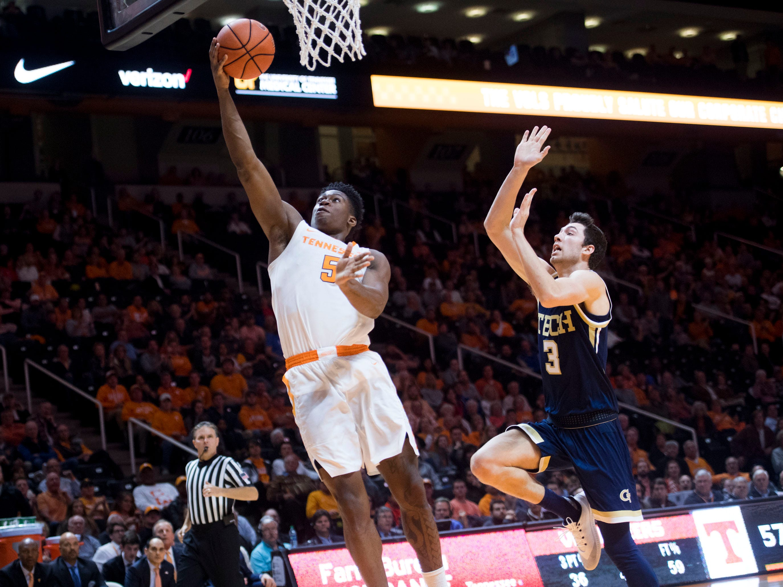 Tennessee's Admiral Schofield (5) scores while defended by Georgia Tech's Evan Cole (3) on Wednesday, November 14, 2018.
