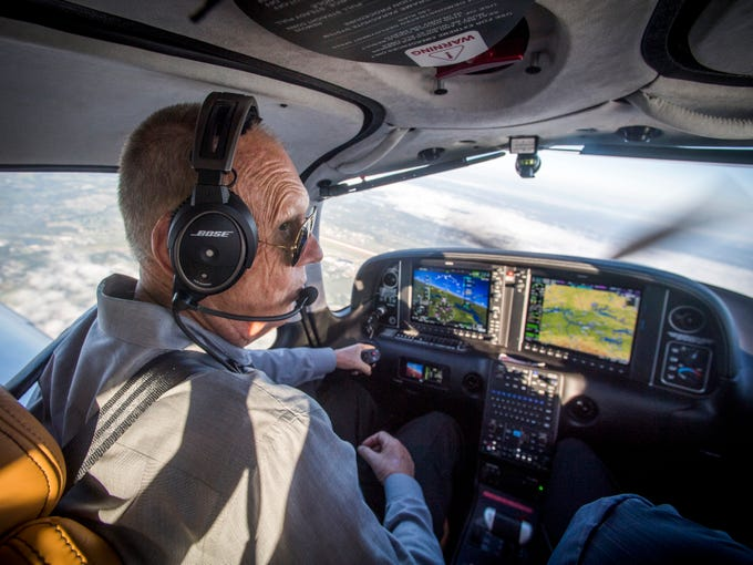 Metropolitan Knoxville Airport Authority president Bill Marrison pilots a Cirrus aircraft near McGhee Tyson Airport on Friday, Sept. 7, 2018. Marrison announced his retirement and will leave his post on December 31 after 36 years with MKAA.