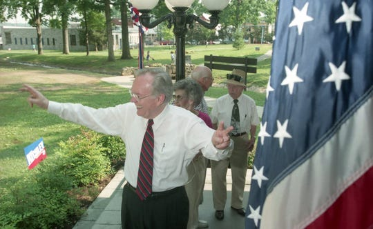 Ben Atchley jokes around with one of his supporters at Fountain City Park where he announced his re-election bid at a political rally on June 14, 1996.