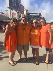 Dara Sarshuri (second from the left), before his weight loss, prepares to watch a Vol game with friends and family.