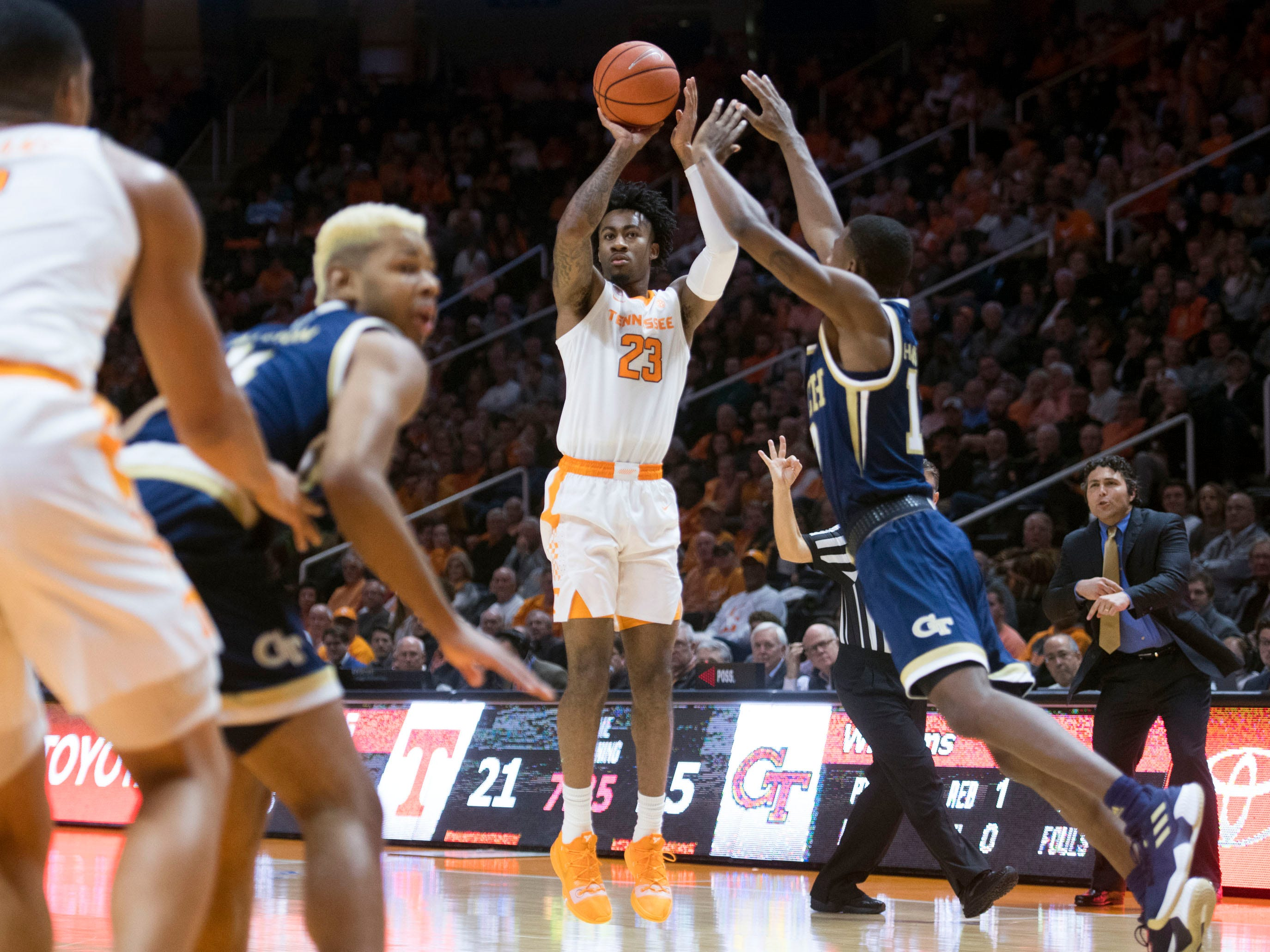 Tennessee's Jordan Bowden (23) scores 3-points while defended by Georgia Tech's Curtis Haywood II (13) at Thompson-Boling Arena on Tuesday, November 13, 2018.
