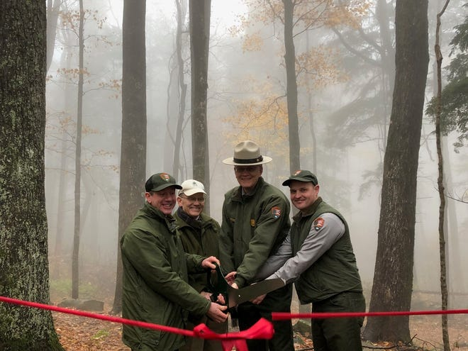 A ribbon-cutting ceremony with park officials officially reopened the Rainbow Falls trail for the public.