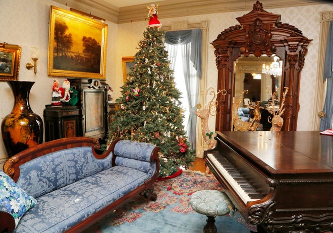 A Christmas tree and other holiday decorations have graced the drawing room inside the Haan Mansion Museum in Lafayette.