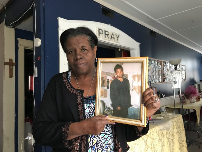Gearaldine Cadwallader holds a picture of her son, Jerry Shephard. She is looking for her son, whom she hasn't heard from in nearly 18 years. She filed a missing person report Tuesday.