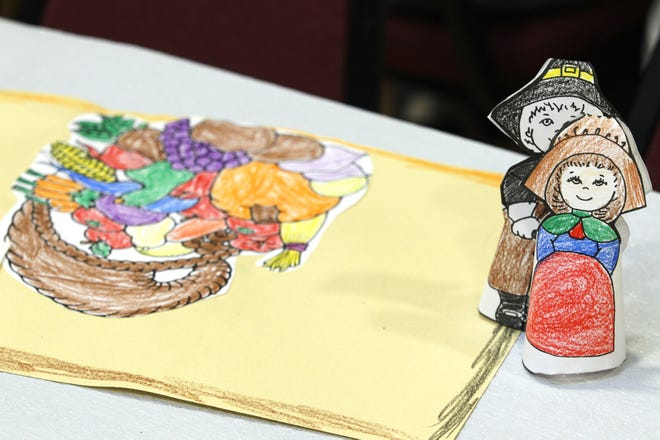 Colorful place mats with a Thanksgiving theme decorate the tables for the 25th Annual Community Thanksgiving Dinner Thursday, November 25, 2010, at Central Presbyterian Church, 31 North Seventh Street in Lafayette. Lafayette Urban Ministry organized the event.