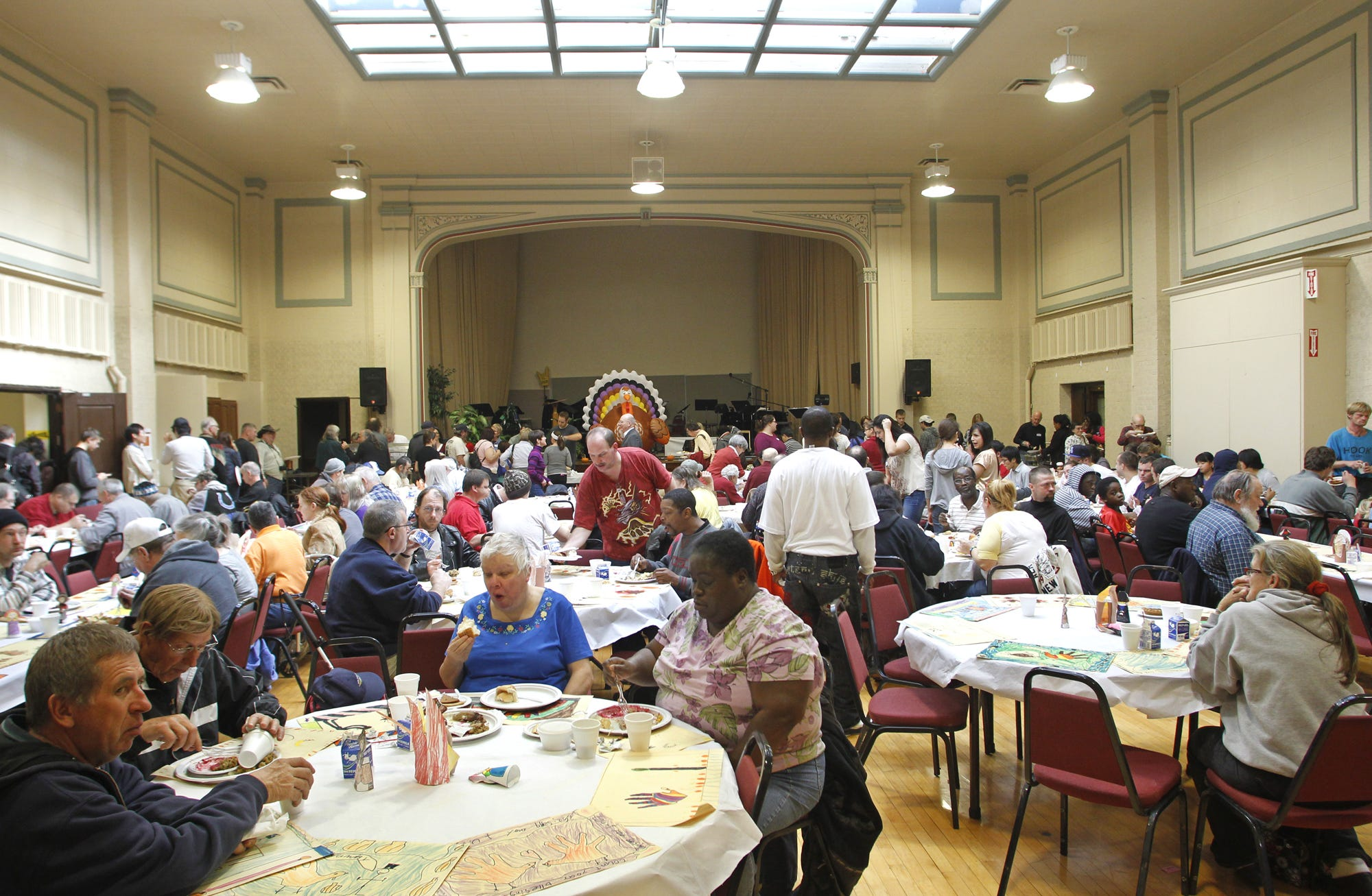 Guests fill the Education Building at Central Presbyterian Church for Lafayette Urban Ministry's Community Thanksgiving Celebration Thursday, November 22, 2012, at Central Presbyterian Church in Lafayette. LUM executive director Joe Micon estimated 800-900 would be served at this year's meal.