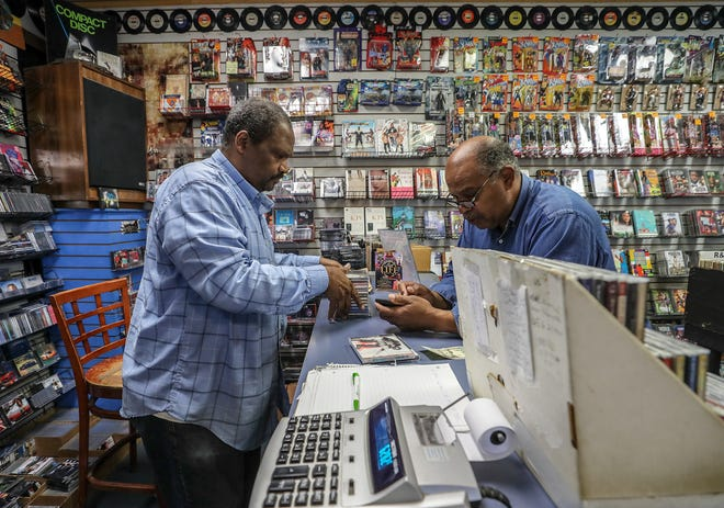 Ben Jones, left owner of Better Days West, record store in west Louisville, talks with Howard Saffel who drives to the store from St. Matthews just to see if he can find a gem among the stacks of CDs and vinyl records.November 7, 2018