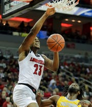 Louisville's Steven Enoch with the slam over Southern's Brian Assie at the KFC Yum! Center in Louisville, Ky. 