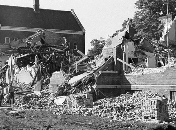 Many of the buildings at the Boys Training School in Lansing were torn down in October 1973. Established in 1856, the school served as a reform school for boys until it closed in 1972.