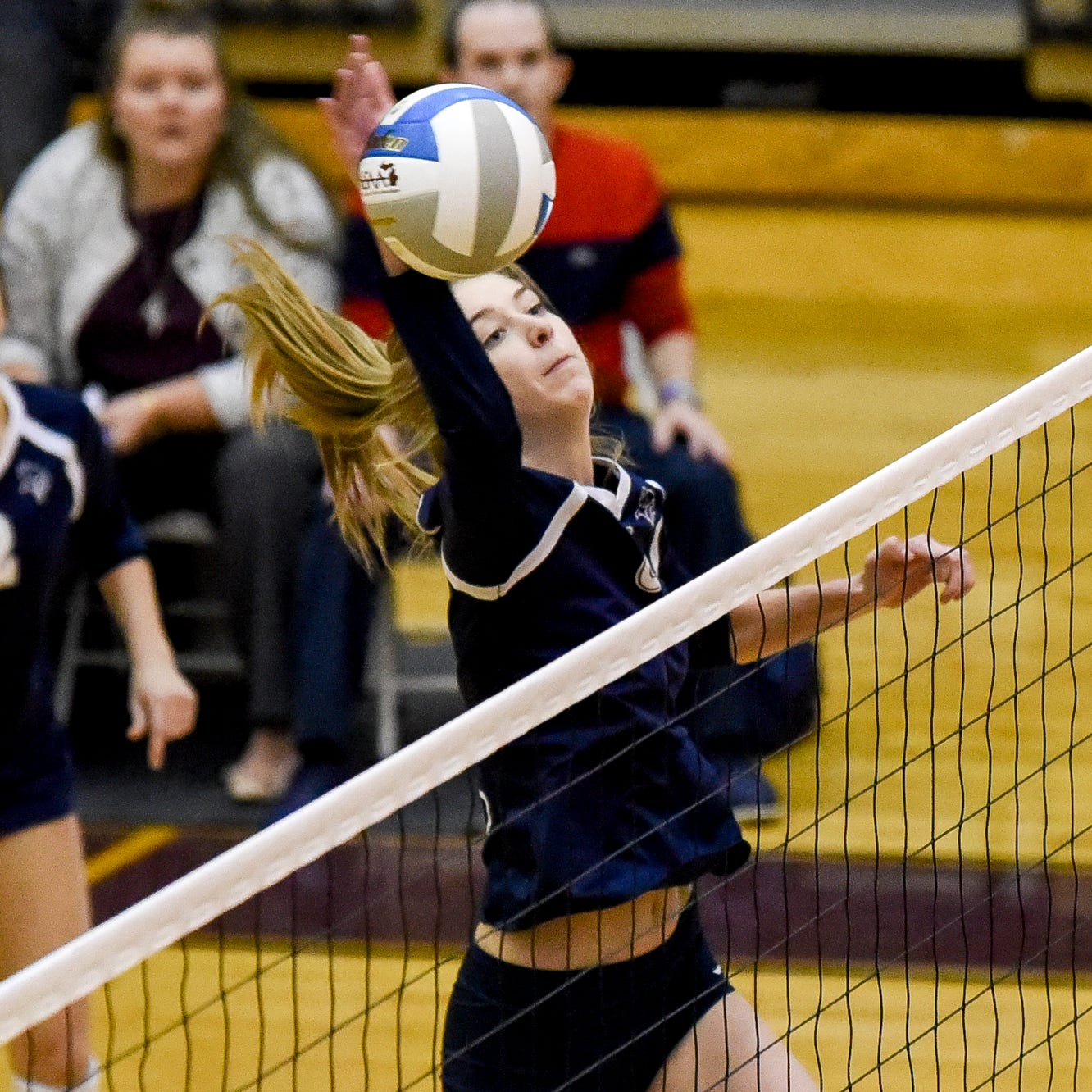 Lakewood's Aubrey O'Gorman hits the ball over the net during the first set against Wixom St. Catherine on Tuesday, Nov. 13, 2018, at Fowlerville High School.