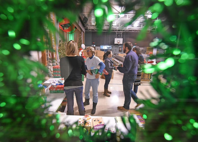 Volunteers pack boxes with gifts Wednesday morning at Freedom Ridge Church for the Samaritan's Purse Operation Christmas Child.
