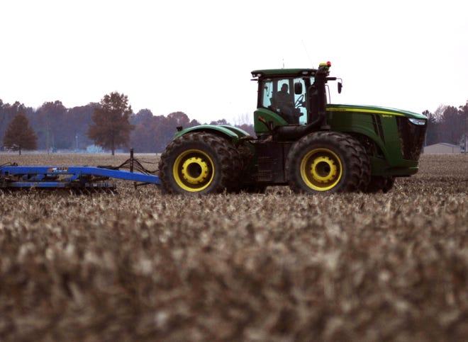 A farmer tills a field west of Crestline on a November afternoon.