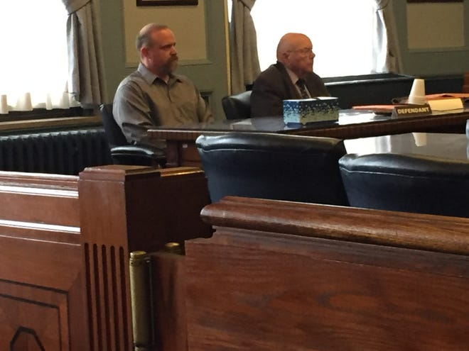 Former state trooper Tyler Anderson, left, sits with defense attorney Bob Whitney in Ashland County Common Pleas Court at his change-of-plea hearing in November..