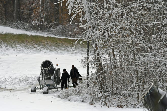 Snow Trails employees prepare snow-making machines for production on Wednesday afternoon.