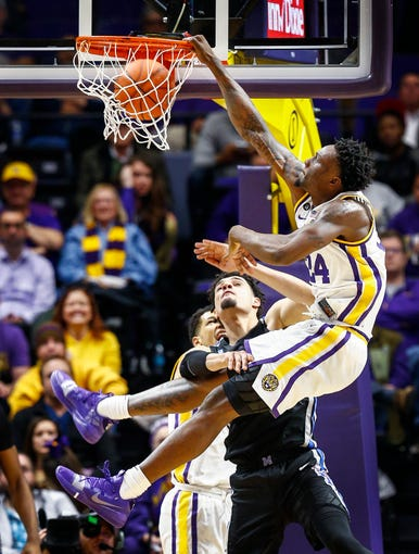 LSU forward Emmitt Williams (top) dunks over Memphis defender Isaiah Maurice (bottom) during action in Baton Rouge, La., Tuesday, November 13, 2018.