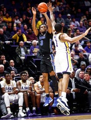 Memphis guard Jeremiah Martin (left) puts up a 3-pointer against LSU defender Ja'vonte Smart (right) during first half action in Baton Rouge, La., Tuesday, November 13, 2018.